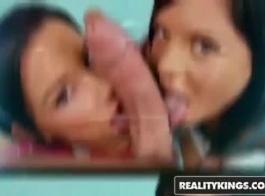 امرأة سمراء ذات مظهر جيد مع شعر طويل يطهي وينينج بينما يعيق حبيبها فيديو لها.